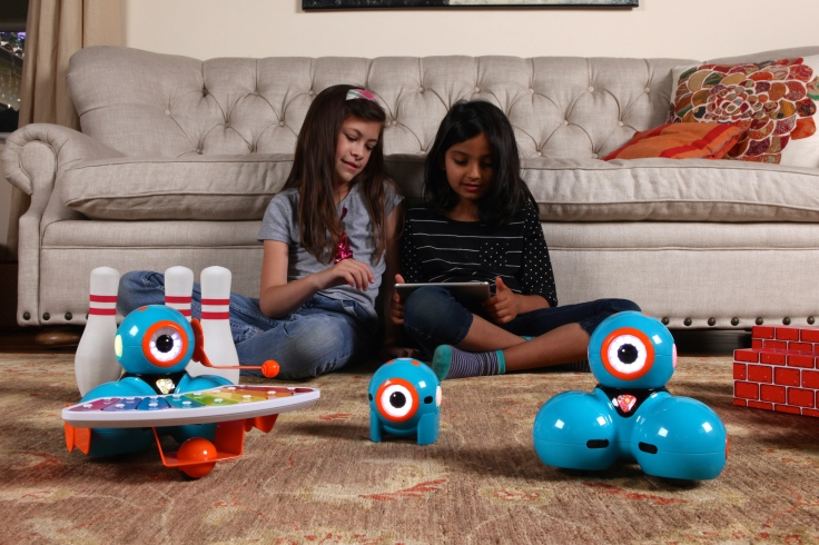 Girls, ages 8 and 9 playing with Dash & Dot.JPG